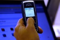 Главный принцип PortWise - использование для задач аутентификации мобильных телефонов и КПК