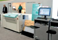Пример реализации гибридного техпроцесса — CTP Fujifilm на стенде Xerox. На противоположной стороне стенда была офсетная машина от Heidelberg