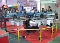 Карусельный трафаретный полуавтомат M&R Sportsman 6/8 (cтенд Stencart) может оснащаться датчиками контроля наличия футболок на печатном столе