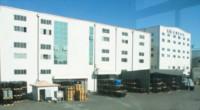 Вид на производство из окна офиса. Справа налево: склад сырья, цех подготовки связующих, цех смешения, склад готовой продукции, упаковочный участок и исследовательский отдел