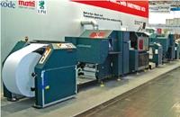 Стенд Nipson. Регулируемая система натяжения машины VaryPress 500 позволяет печатать на широком спектре материалов: этикеточной бумаге и лёгком картоне, фольге, пластиковых картах