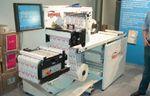 Стенд Hewlett-Packard. При оснащении двумя камерами контрольно-инспекционная система ABG fleyeVision контролирует полотно с обеих сторон