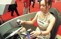Один из прототипов, разработанный в Tokai Rika, был оснащен устройством управления, напоминавшим штурвал самолета. Внутри его рукояток располагаются два управляющих элемента, нажатие на которые большим пальцем инициирует ускорение или торможение