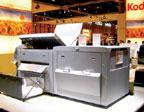 В состав CTP Kodak Magnus 800 включается система пробивки пластин с 10-ю настраиваемыми пользователем перфорационными головками