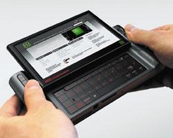 Прототип мобильного мультимедийного устройства сподключением кInternet (Mobile Internet Multimedia Device, MIMD) снабжен выдвижной клавиатурой, сенсорным экраном диагональю 4,5 дюйма иразрешением 1024х600 точек, атакже камерой разрешением 3,2 мегапиксела