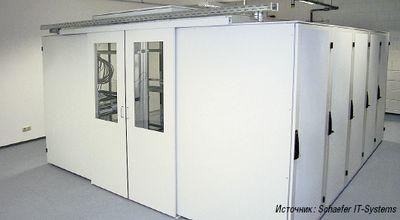 Рисунок 1. Корпусное решение от Schaefer с крышей, слегка приподнятой над рядами шкафов, обеспечивает оптимальную подачу холодного воздуха.