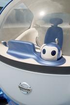 Robot Agent, который устанавливается на управляющей панели концепт-кара Nissan Pivo 2, посредством встроенных камер фиксирует мимику водителя и определяет, настолько тот устал или нервничает